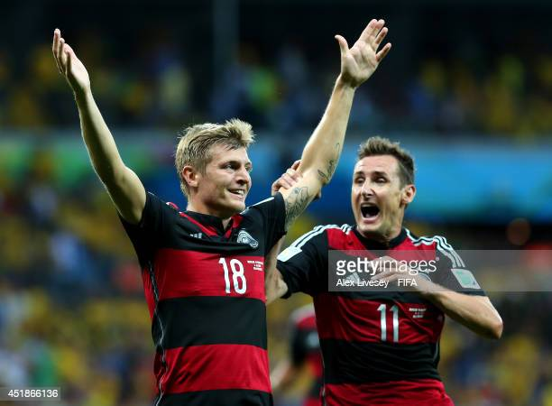 Toni Kroos of Germany celebrates scoring his team's third goal withi his teammate Miroslav Klose during the 2014 FIFA World Cup Brazil Semi Final...