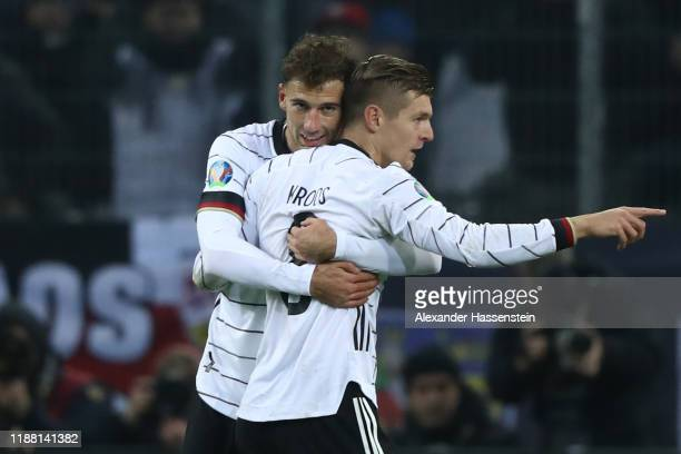 Toni Kroos of Germany celebrates scoring the 3rd goal with his team mate Leon Goretzka during the UEFA Euro 2020 Qualifier between Germany and...