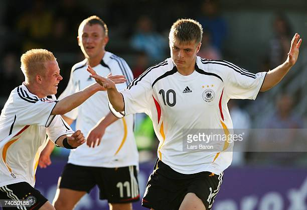Toni Kroos of Germany celebrates scoring the second goal with team mate Sascha Bigalke during the 2007 UEFA European Under 17 Championship Group A...
