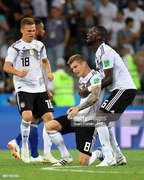 Toni Kroos of Germany celebrates victory with teammates Antonio Ruediger and Joshua Kimmich during the 2018 FIFA World Cup Russia group F match...