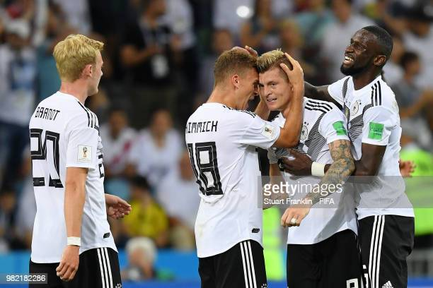 Toni Kroos of Germany celebrates victory with teammates Julian Brandt Antonio Ruediger and Joshua Kimmich during the 2018 FIFA World Cup Russia group...