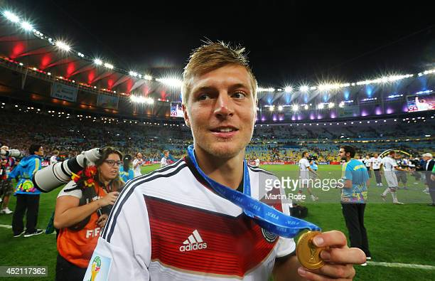 Toni Kroos of Germany celebrates with his medal after defeating Argentina 10 in extra time during the 2014 FIFA World Cup Brazil Final match between...