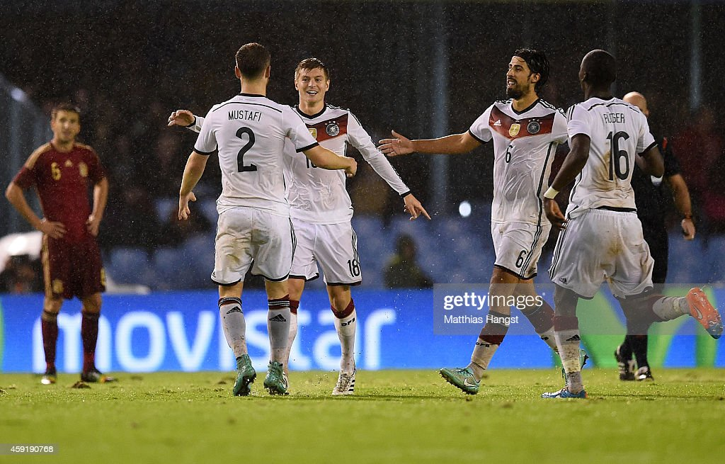 Toni Kroos (2nd L) of Germany celebrates with his team-mates after scoring the opening goal during the International Friendly match between Spain and Germany at Estadio Balaidos on November 18, 2014 in Vigo, Spain.