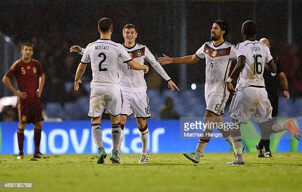 Toni Kroos of Germany celebrates with his teammates after scoring the opening goal during the International Friendly match between Spain and Germany...