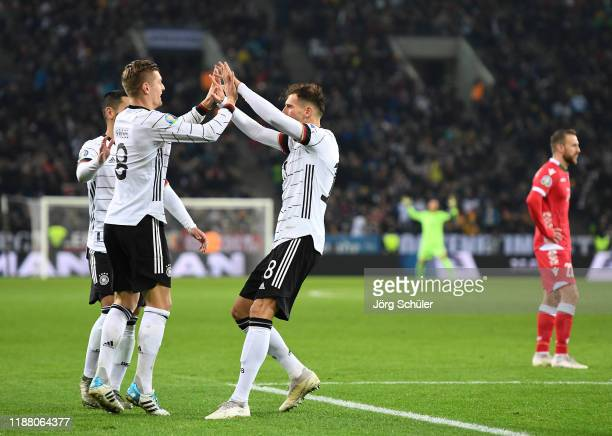 Toni Kroos of Germany celebrates with team mate Leon Goretzka after scoring their team during the UEFA Euro 2020 Group C Qualifier match between...