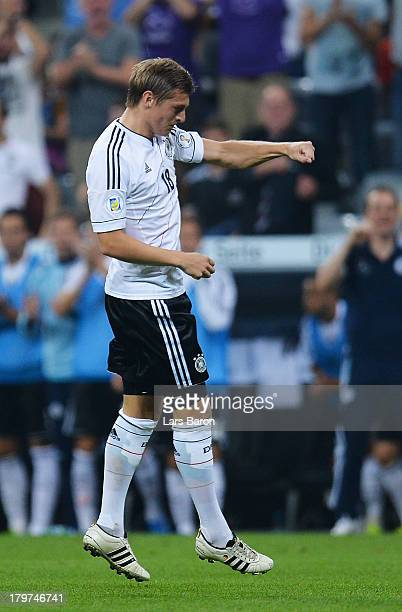 Toni Kroos of Germany celebrates with team mate Miroslav Klose after scoring his teams second goal during the FIFA 2014 World Cup Qualifying Group C...