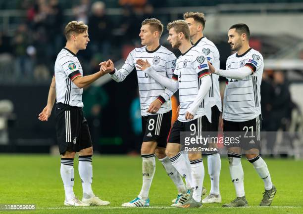 Toni Kroos of Germany celebrates with team mates after scoring his team's third goal during the UEFA Euro 2020 Qualifier between Germany and Belarus...