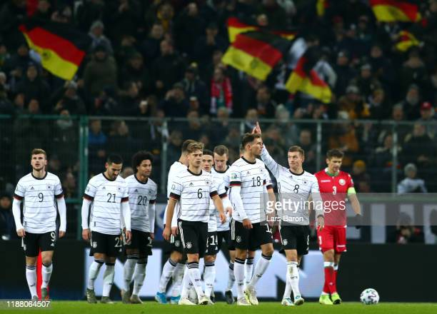 Toni Kroos of Germany celebrates with team mates after scoring their team's third goal during the UEFA Euro 2020 Group C Qualifier match between...