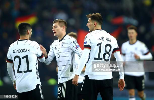 Toni Kroos of Germany celebrates with team mates Leon Goretzka and Ilkay Gundogan after scoring their team's third goal during the UEFA Euro 2020...