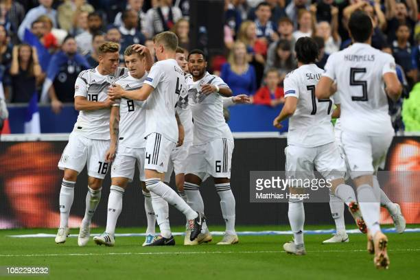 Toni Kroos of Germany celebrates with teammates after scoring his team's first goal during the UEFA Nations League A group one match between France...