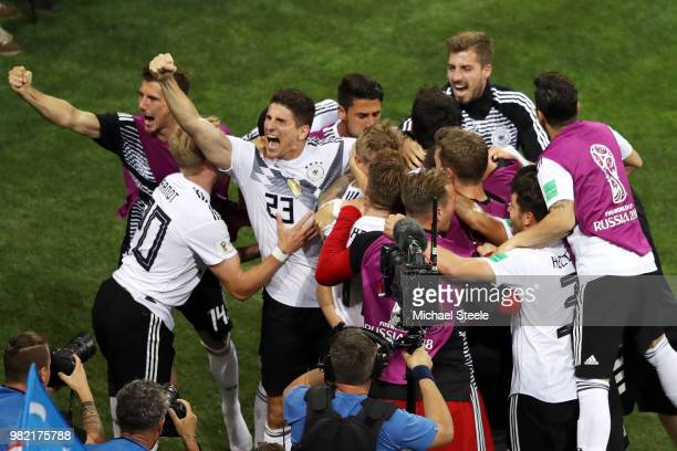 Toni Kroos of Germany celebrates with teammates after scoring his sides winning goal during the 2018 FIFA World Cup Russia group F match between...