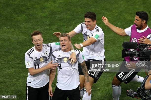 Toni Kroos of Germany celebrates with teammates Marco Reus and Mario Gomez after scoring his sides winning goal during the 2018 FIFA World Cup Russia...