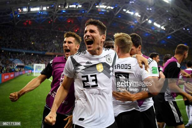 Toni Kroos of Germany celebrates with teammates scoring his sides winning goal during the 2018 FIFA World Cup Russia group F match between Germany...