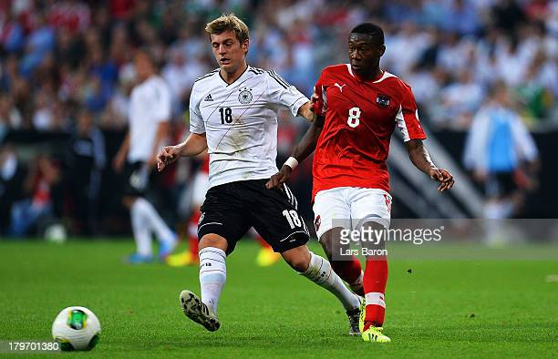 Toni Kroos of Germany challenges David Alaba of Austria during the FIFA 2014 World Cup Qualifying Group C match between Germany and Austria Allianz...