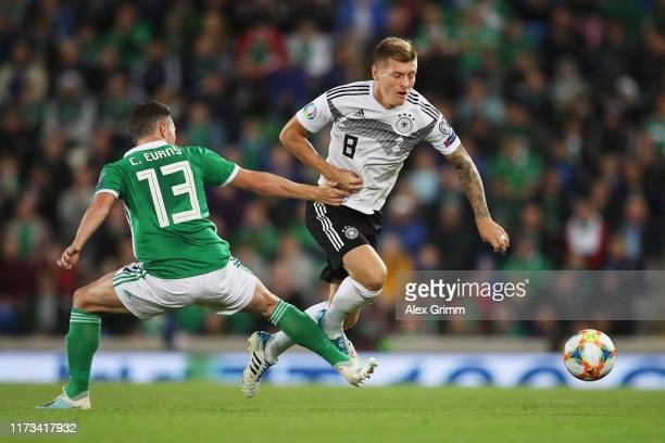 Toni Kroos of Germany challenges for the ball with Corry Evans of Northern Ireland during the UEFA Euro 2020 qualifier match between Northern Ireland...