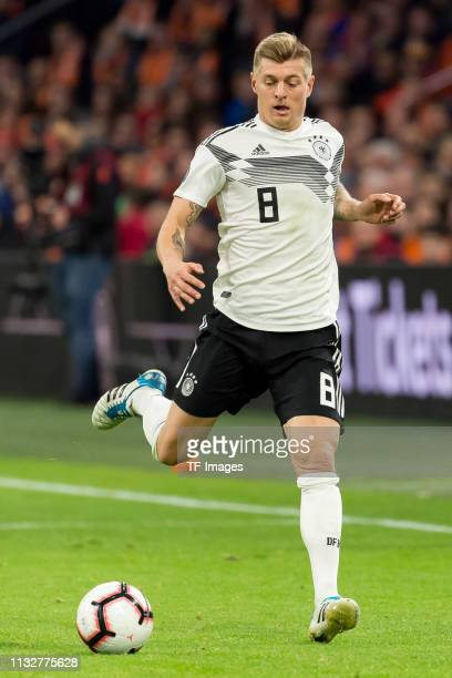 Toni Kroos of Germany controls the ball during the 2020 UEFA European Championships group C qualifying match between Netherlands and Germany at Johan...