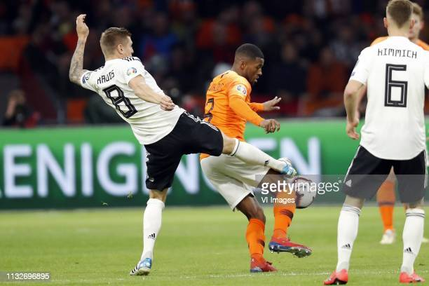 Toni Kroos of Germany Georginio Wijnaldum of Holland during the UEFA EURO 2020 qualifier group C qualifying match between The Netherlands and Germany...
