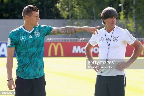 Toni Kroos of Germany gives instrcutions to his team mates next to Joachim Loew head coach of Germany during the Germany Training Session at ZSKA...