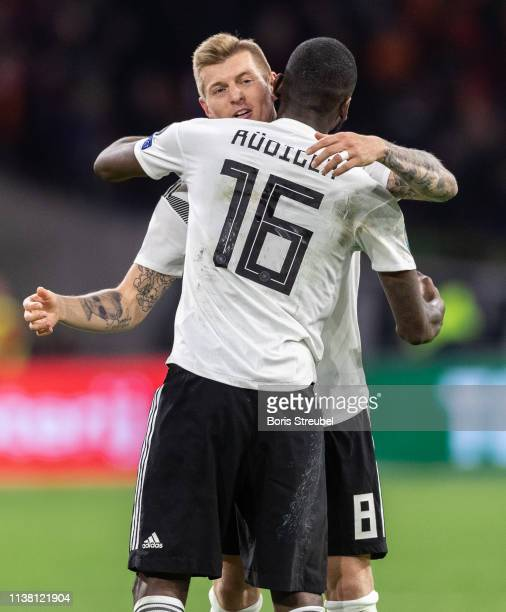 Toni Kroos of Germany hugs Antonio Ruediger of Germany after winning the 2020 UEFA European Championships group C qualifying match between...