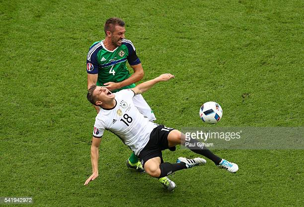 Toni Kroos of Germany is challenged by Gareth McAuley of Northern Ireland during the UEFA EURO 2016 Group C match between Northern Ireland and...