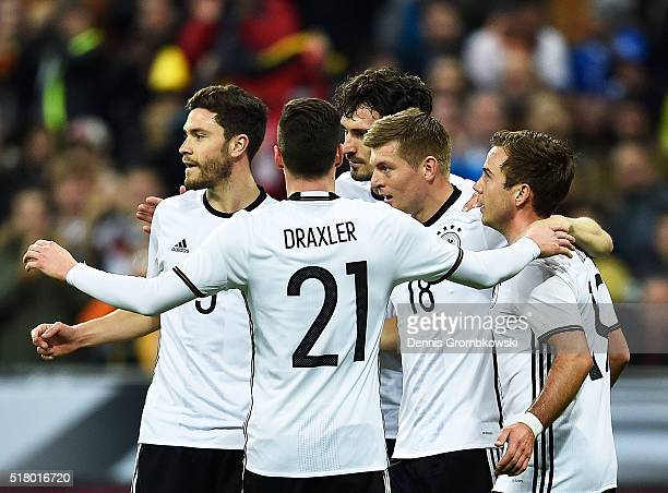 Toni Kroos of Germany is congratulated by Mario Goetze and team mates after scoring a goal during the International Friendly match between Germany...