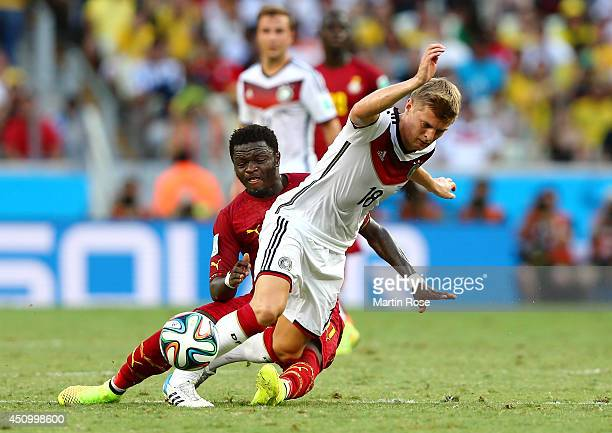 Toni Kroos of Germany is tackled by Sulley Muntari of Ghana during the 2014 FIFA World Cup Brazil Group G match between Germany and Ghana at Castelao...