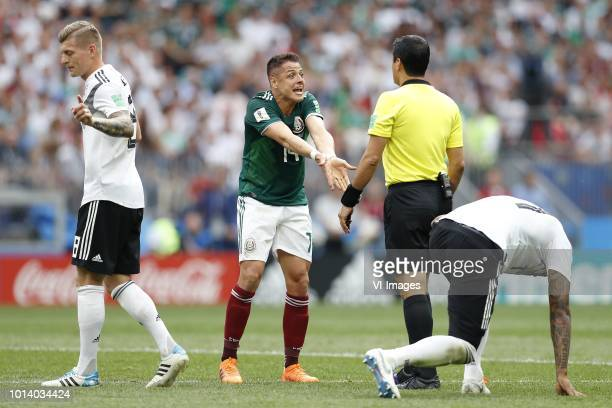 Toni Kroos of Germany Javier Hernandez of Mexico referee Alireza Faghani Jerome Boateng of Germany during the 2018 FIFA World Cup Russia group F...