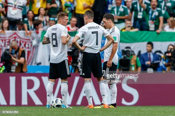 Toni Kroos of Germany Julian Draxler of Germany and Mesut Oezil of Germany gestures during the 2018 FIFA World Cup Russia group F match between...