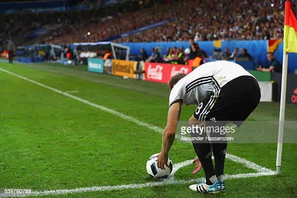 Toni Kroos of Germany prepares the ball for a corner kick during the UEFA EURO 2016 Group C match between Germany and Ukraine at Stade PierreMauroy...