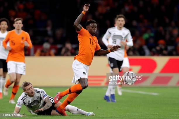 Toni Kroos of Germany Quincy Promes of Holland during the EURO Qualifier match between Holland v Germany at the Johan Cruijff Arena on March 24 2019...
