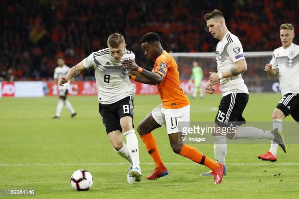 Toni Kroos of Germany Quincy Promes of Holland Niklas Sule of Germany Joshua Kimmich of Germany during the UEFA EURO 2020 qualifier group C...