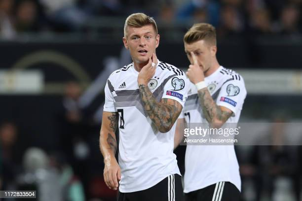 Toni Kroos of Germany reacts with team mate Marco Reus during the UEFA Euro 2020 qualifier match between Germany and Netherlands at Volksparkstadion...