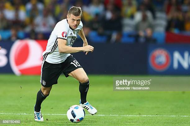 Toni Kroos of Germany runs with the ball during the UEFA EURO 2016 Group C match between Germany and Ukraine at Stade PierreMauroy on June 12 2016 in...