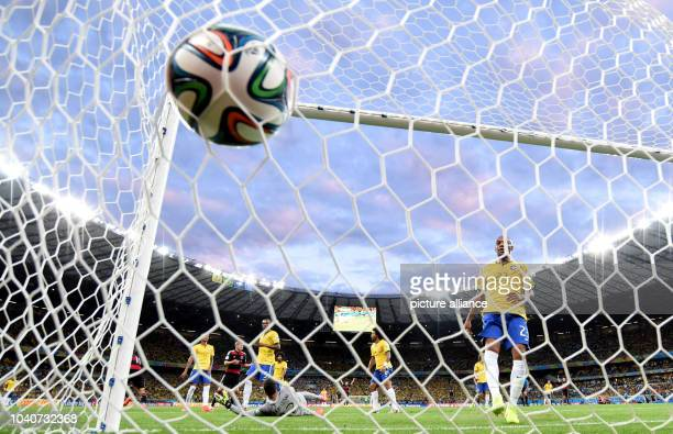 Toni Kroos of Germany scores 0-3 goal next to Brazil's Maicon , Fred and goalkeeper Julio Cesar during the FIFA World Cup 2014 semi-final soccer...