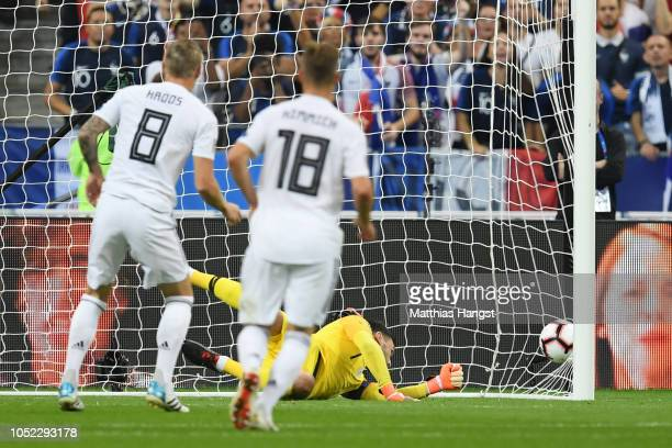 Toni Kroos of Germany scores a penalty for his sides first goal during the UEFA Nations League A group one match between France and Germany at Stade...
