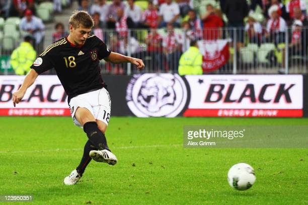 Toni Kroos of Germany scores his team's first goal with a penalty during the International friendly match between Poland and Germany at PGE Arena on...