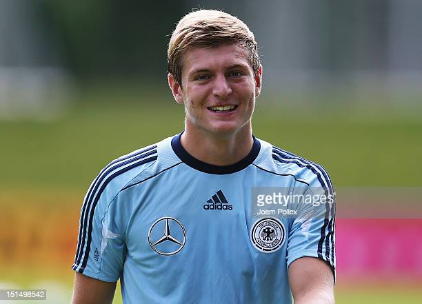 Toni Kroos of Germany smiles during a training session ahead of their FIFA World Cup Brazil 2014 qualifier against Austria on September 8, 2012 in...