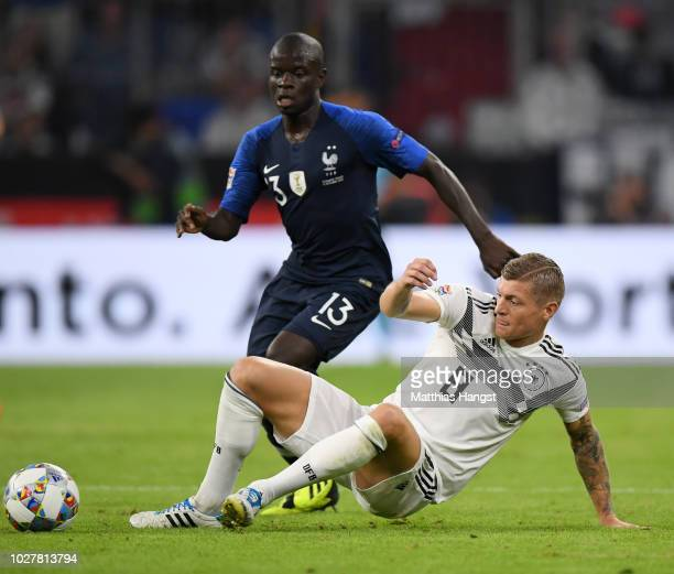 Toni Kroos of Germany tackles N'Golo Kante of France during the UEFA Nations League Group A match between Germany and France at Allianz Arena on...