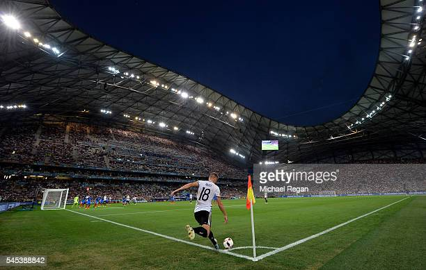 Toni Kroos of Germany takes a corner during the UEFA EURO semi final match between Germany and France at Stade Velodrome on July 7, 2016 in...