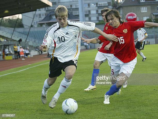 Toni Kroos of Germany vies for the ball with Roman Amirhanov of Russia during the UEFA Under 17 European Championship semi final match between...