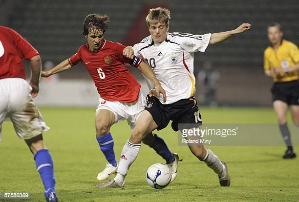 Toni Kroos of Germany vies for the ball with Vacim Gagloev Captain of Russia during the UEFA Under 17 European Championship semi final match between...