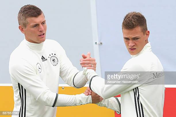 Toni Kroos of Germany warms up with his team mate Joshua Kimmich during a training session at stadio communale on day 10 of the German national team...