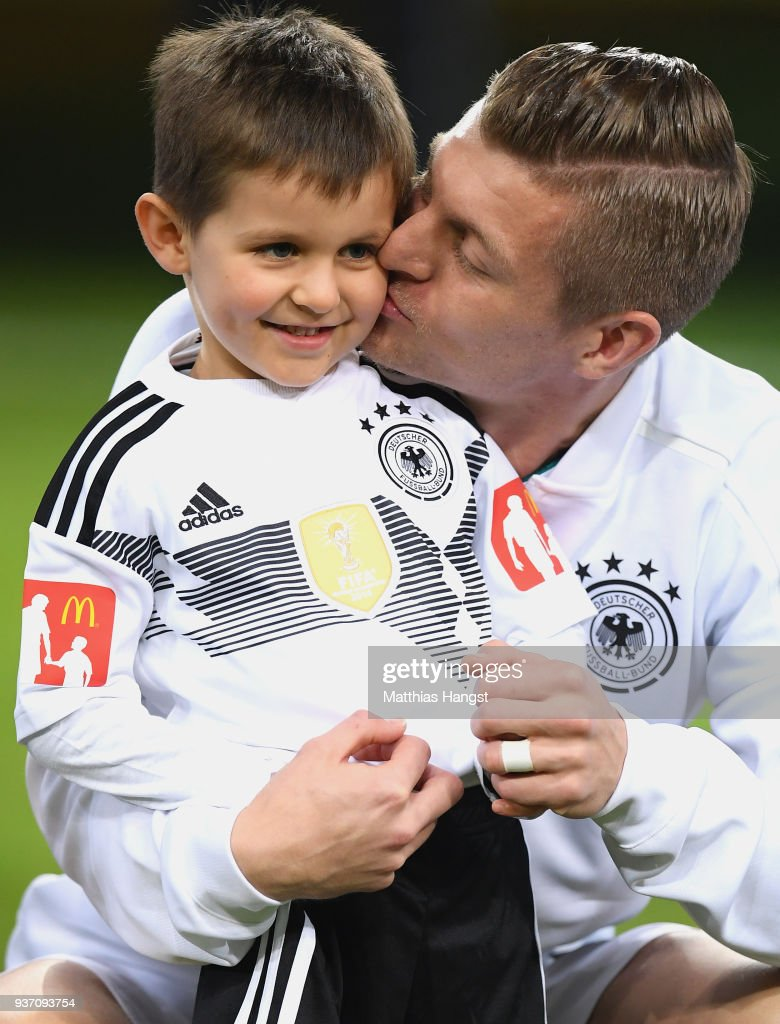 Toni Kroos of Germany with his son prior to the International friendly match between Germany and Spain at Esprit-Arena on March 23, 2018 in Duesseldorf, Germany.