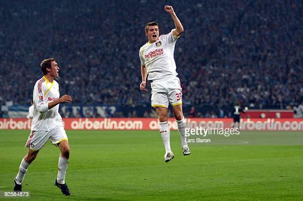 Toni Kroos of Leverkusen celebrates scoring his team's first goal during the Bundesliga match between FC Schalke 04 and Bayer 04 Leverkusen at the...