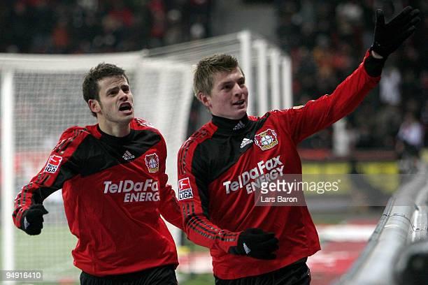 Toni Kroos of Leverkusen celebrates scoring his teams third goal with team mate Tranquillo Barnetta during the Bundesliga match between Bayer...
