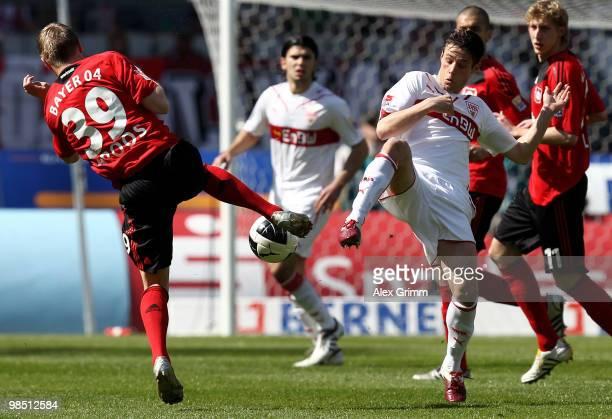 Toni Kroos of Leverkusen is challenged by Christian Traesch of Stuttgart during the Bundesliga match between VfB Stuttgart and Bayer Leverkusen at...