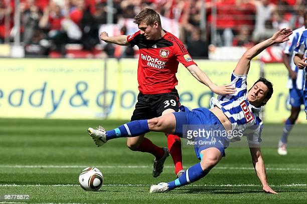 Toni Kroos of Leverkusen is challenged by Gojko Kacar of Berlin during the Bundesliga match between Bayer Leverkusen and Hertha BSC Berlin at the...