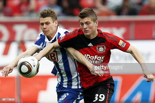Toni Kroos of Leverkusen is challenged by Lukasz Piszczek of Berlin during the Bundesliga match between Bayer Leverkusen and Hertha BSC Berlin at the...