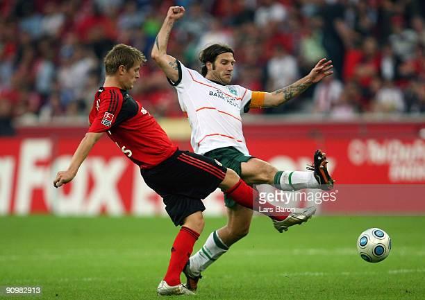 Toni Kroos of Leverkusen is challenged by Torsten Frings of Bremen during the Bundesliga match between Bayer Leverkusen and Werder Bremen at BayArena...