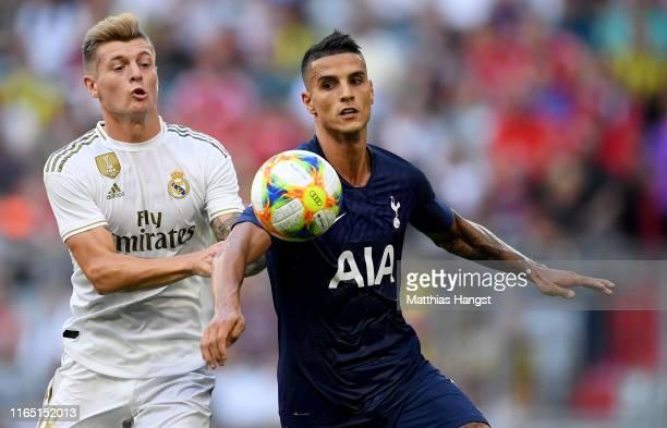 Toni Kroos of Madrid challenges Erik Manuel Lamela Cordero of Tottenham during the Audi Cup 2019 semi final match between Real Madrid and Tottenham...